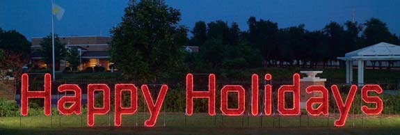 Happy Holidays Garland and LED light Character Display to hang across streets or stake into the ground