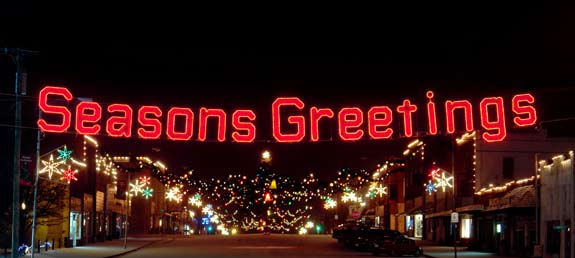 Seasons Greetings Garland and LED light Character Display to hang across streets or stake into the ground