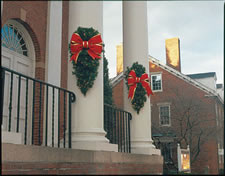 outdoor building columns decorated with designer garden swags for the holidays